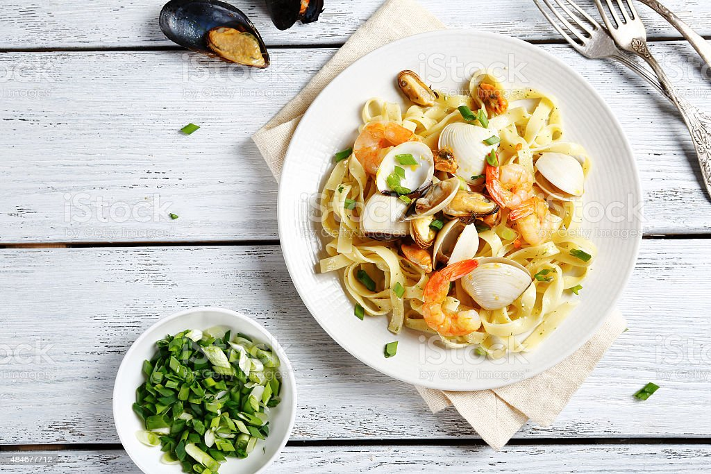 Nutritional pasta with seafood stock photo