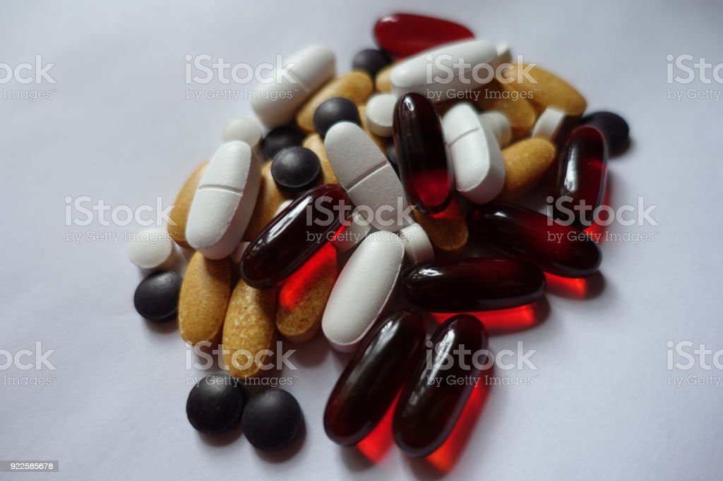 Nutritional supplements in variety of forms, sizes and colors stock photo