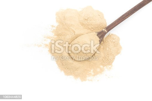 Nutritional yeast in a spoon isolated on white