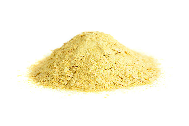 Nutritional yeast Nutritional yeast, natural source of vitamin B. Saccharomyces cerevisiae. yeast stock pictures, royalty-free photos & images