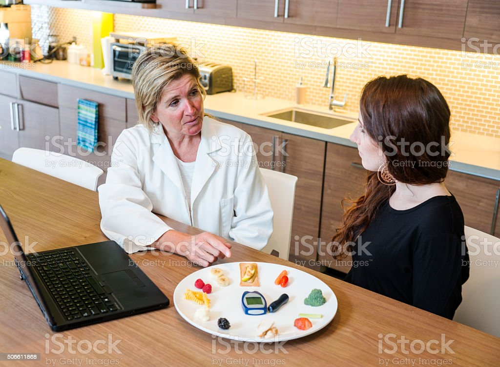 Nutritionist consulting on diabetes stock photo