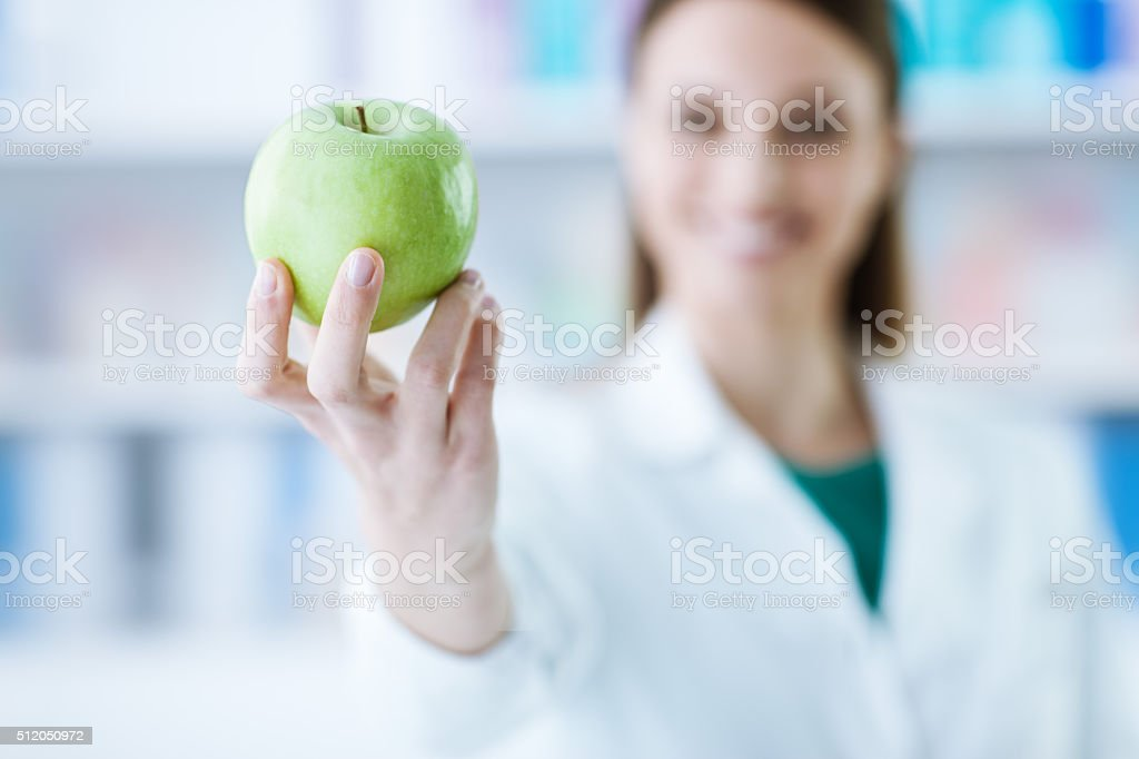 Nutritionist holding an apple stock photo
