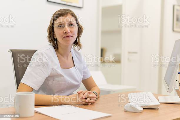Nutritionist In Her Office Working With Computer Stock Photo - Download Image Now