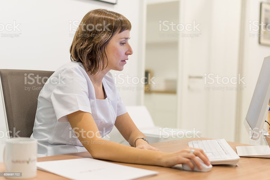 Nutritionist in her office working with computer royalty-free stock photo