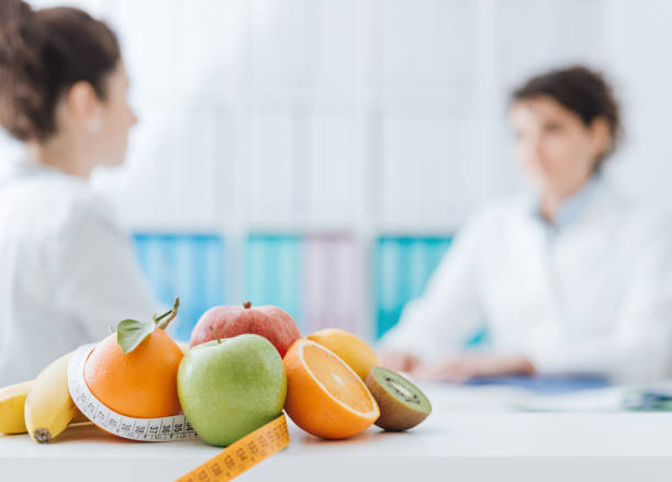 Nutritionist meeting a patient in the office stock photo