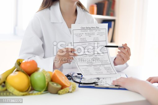 Nutritionist showing nutrition plan