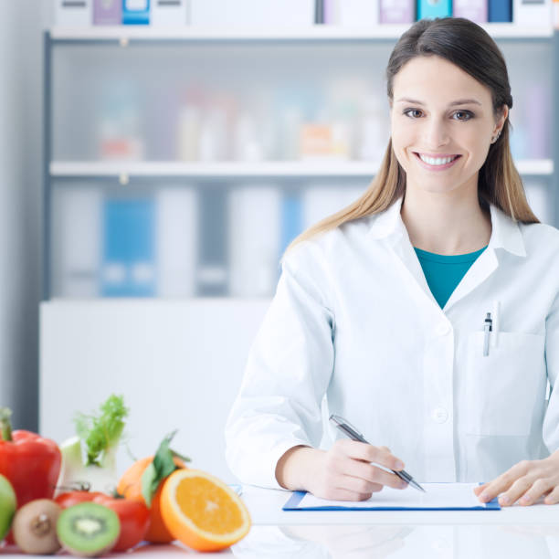 Nutritionist working at office desk