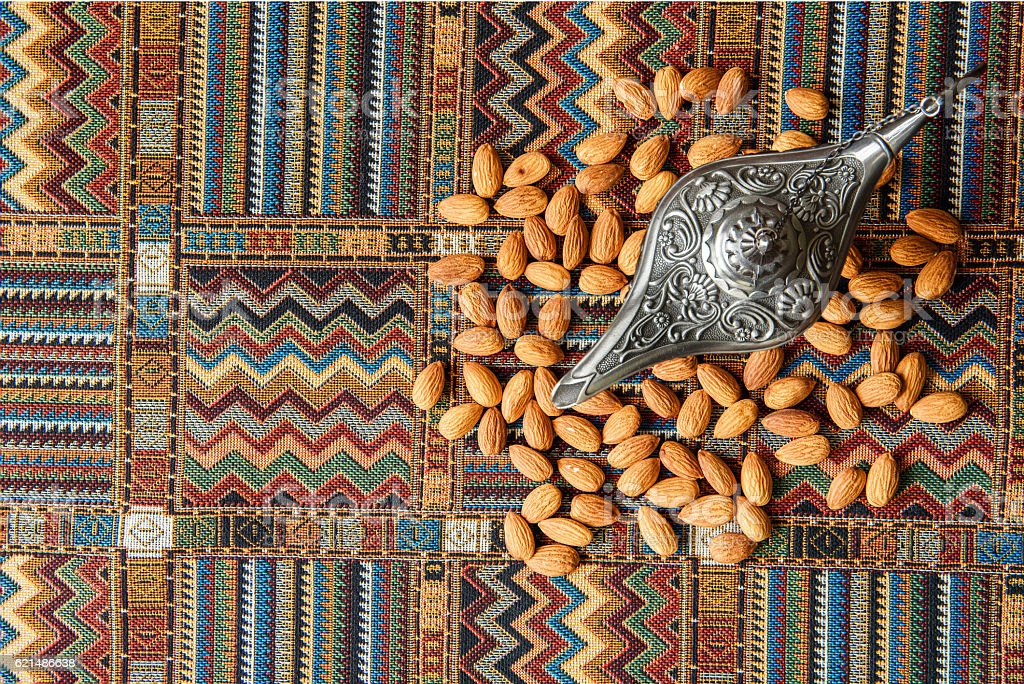 Nuts almonds on a traditional Arabian carpet foto stock royalty-free