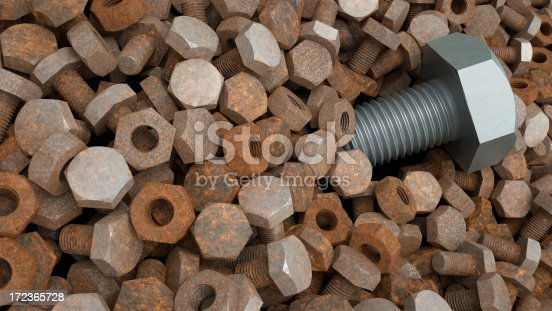 A mountain of rusty nuts and bolts with a single outstanding bolt.  Signifying standing out from the crowd.