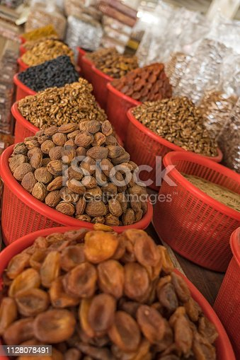 Chickpeas, whole almonds, apricot, kernel, peanuts and dried fruit in large sacks on farmers market.