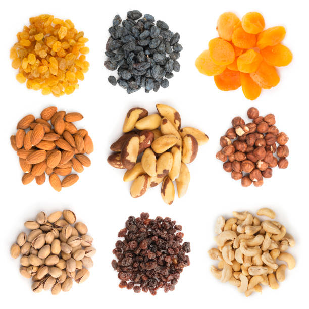nuts and dried fruits collection - dried fruit stock photos and pictures