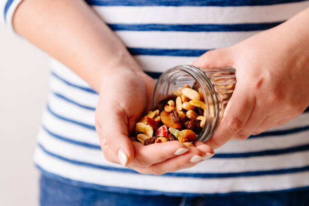 Nuts and dried fruits in hands. Cooking stock photo