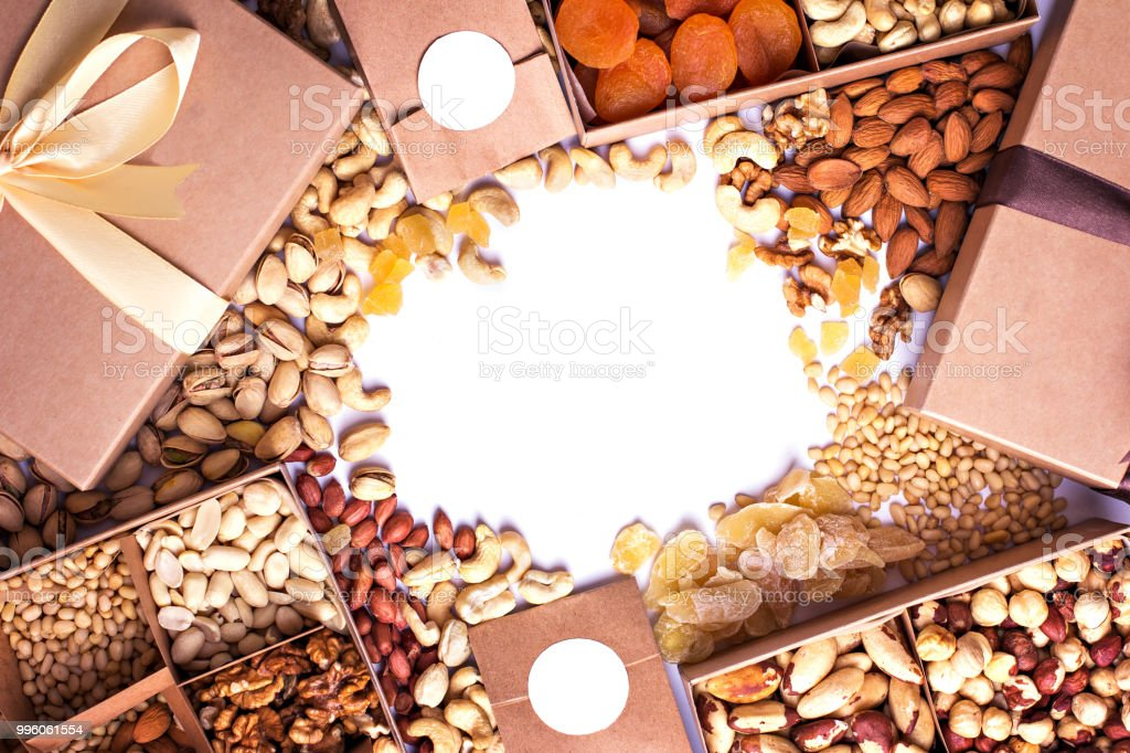 Nuts And Dried Fruits In The Craft Package Photo For The Catalog
