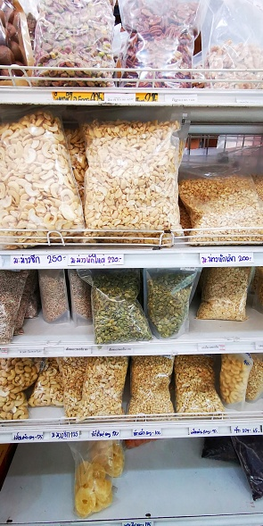 Nuts And Dried Fruits on shelf for sale at market