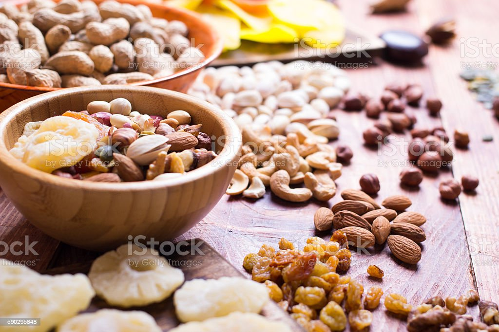 Nuts and dry fruit, in bowls, on boards royaltyfri bildbanksbilder