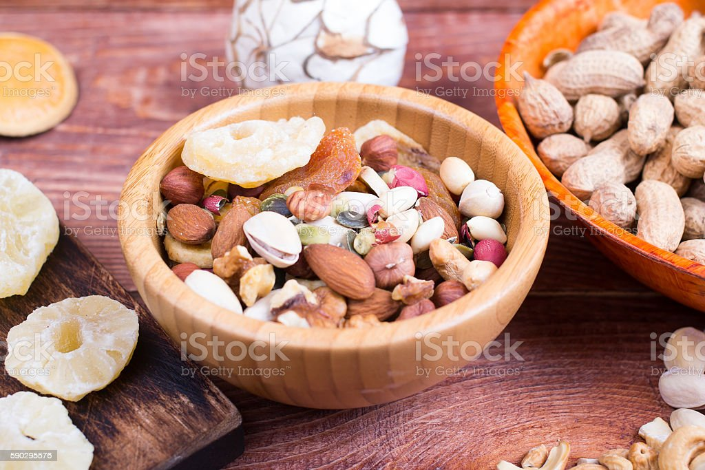 Nuts and dry fruit, in plates, on boards royaltyfri bildbanksbilder