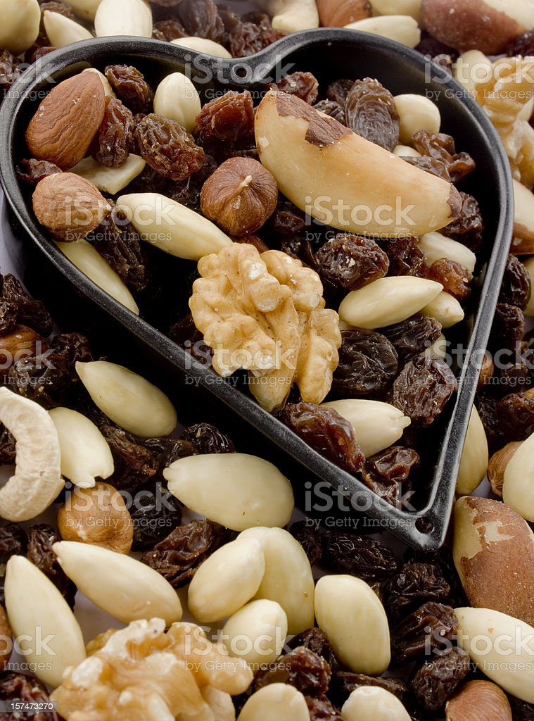 Nuts and raisins in a heart royalty-free stock photo
