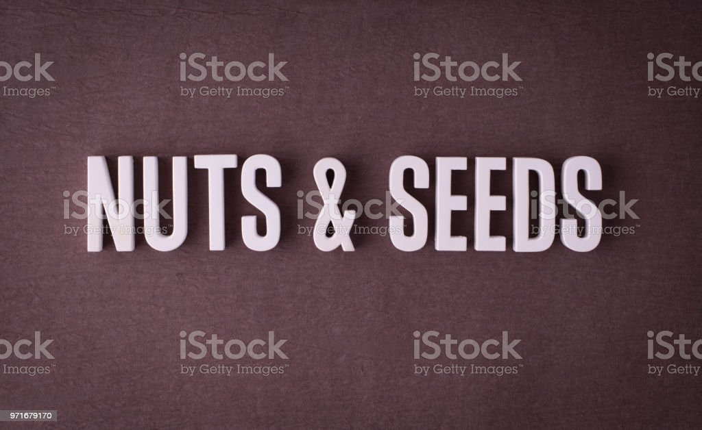 Nuts and seeds lettering sign stock photo
