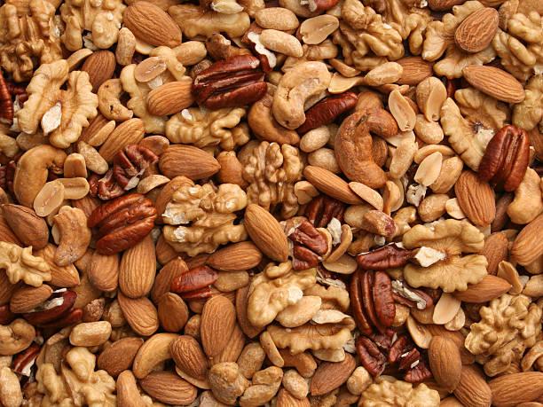 орехи фоне - nuts стоковые фото и изображения