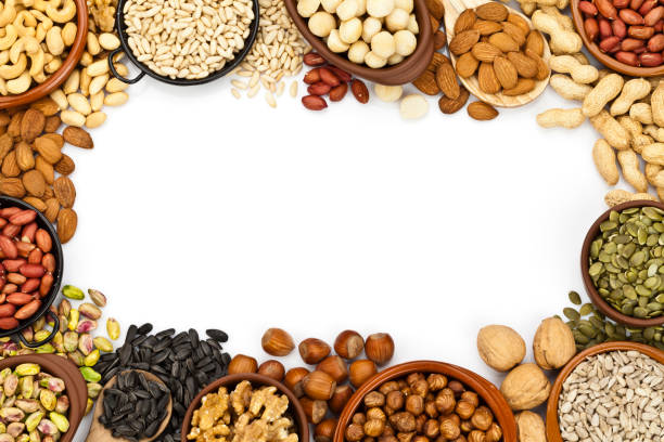 Nuts border on white background stock photo
