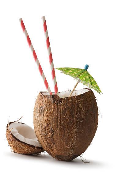 Nuts: Coconut, Umbrella and Straw stock photo
