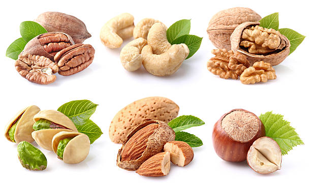 nuts collage - cashew stock photos and pictures