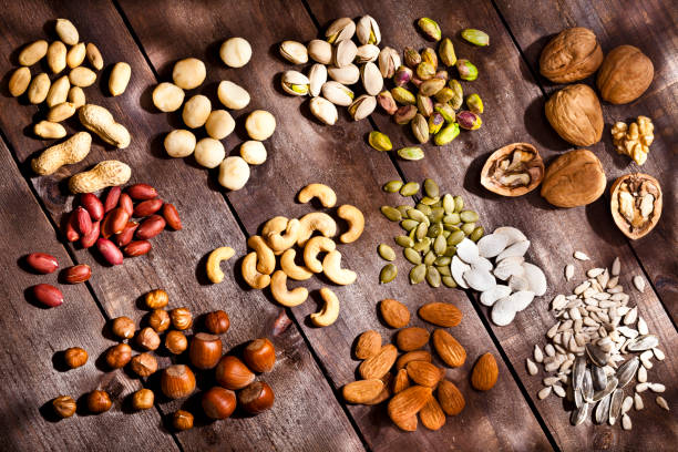 Nuts collection on rustic wood table stock photo