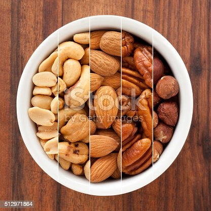 Composite of several shots of nuts in white bowl for variation concept