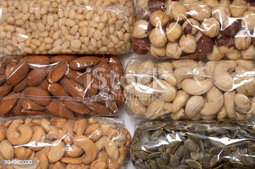 Different nuts in transparent plastic packages.