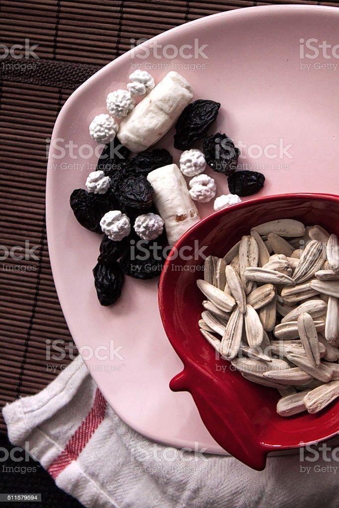 Nuts from top in apple shaped bowl stok fotoğrafı