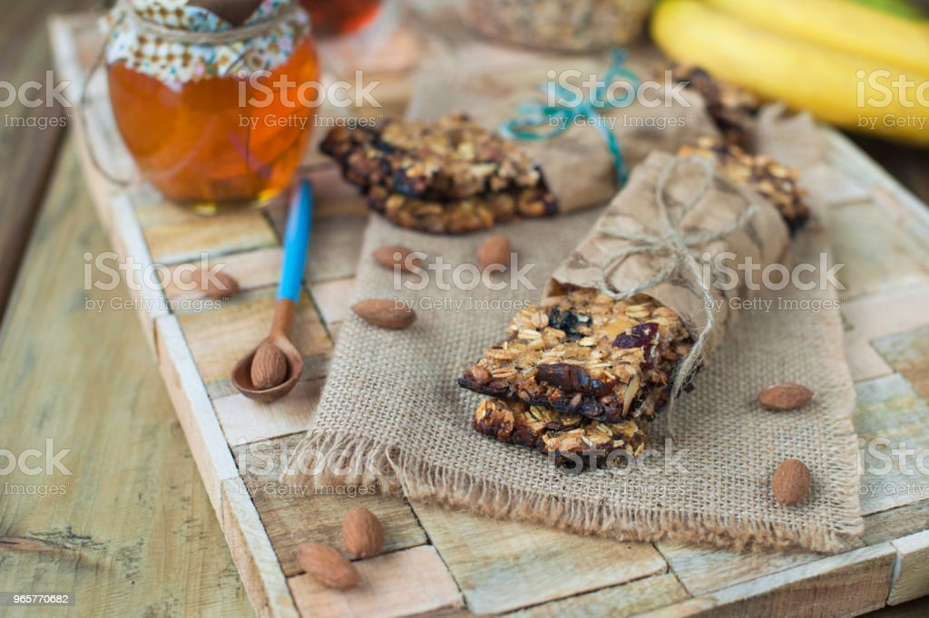 nuts, honey, in a jar and a banana on a wooden table near the eye. Healthy breakfast. Vintage photo. - Royalty-free Almond Stock Photo