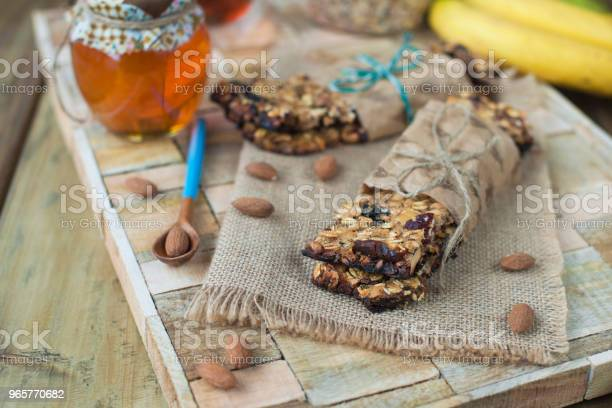 Nuts Honey In A Jar And A Banana On A Wooden Table Near The Eye Healthy Breakfast Vintage Photo Stock Photo - Download Image Now