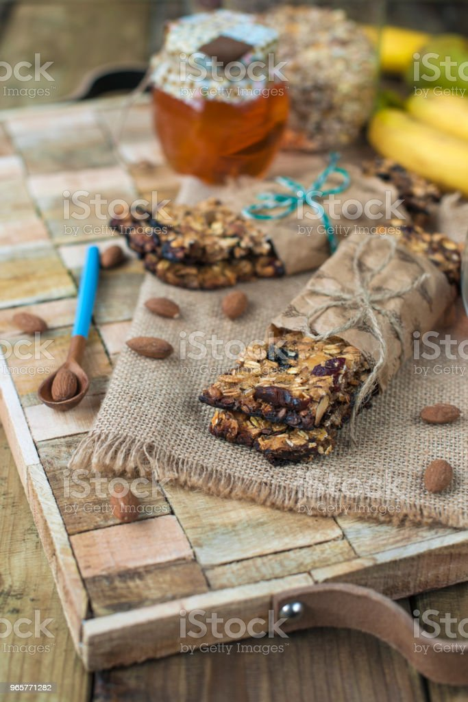 nuts, honey, in a jar and a banana on a wooden table near the eye. Healthy breakfast. Vintage photo - Royalty-free Almond Stock Photo