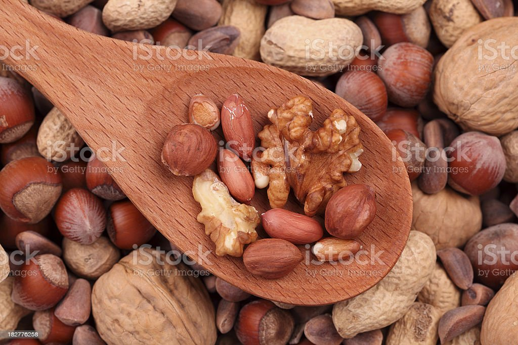 Nuts in a wooden spoon royalty-free stock photo