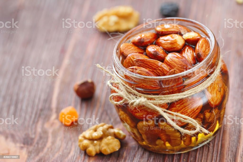 Nuts in honey stock photo