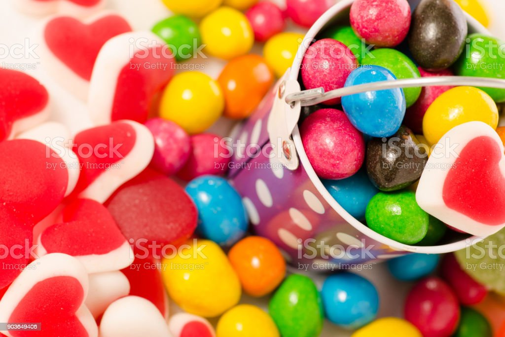 Nuts in multicolored glaze jelly beans jujube jelly candy sweets stock photo