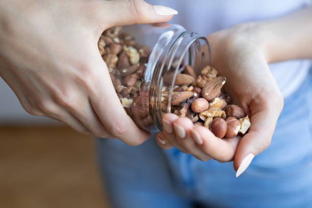 Nuts in woman hands stock photo