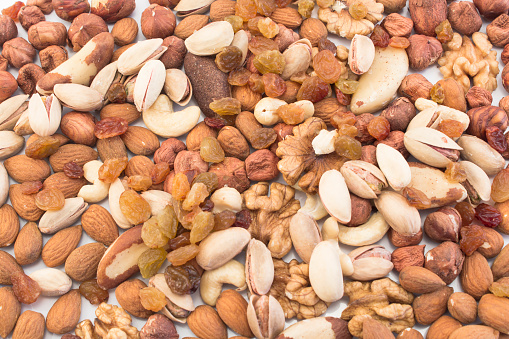 Nuts Mix And Raisins As Background Stock Photo - Download Image Now