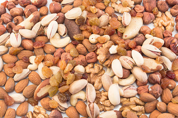 Nuts Mix and Raisins as Background stock photo