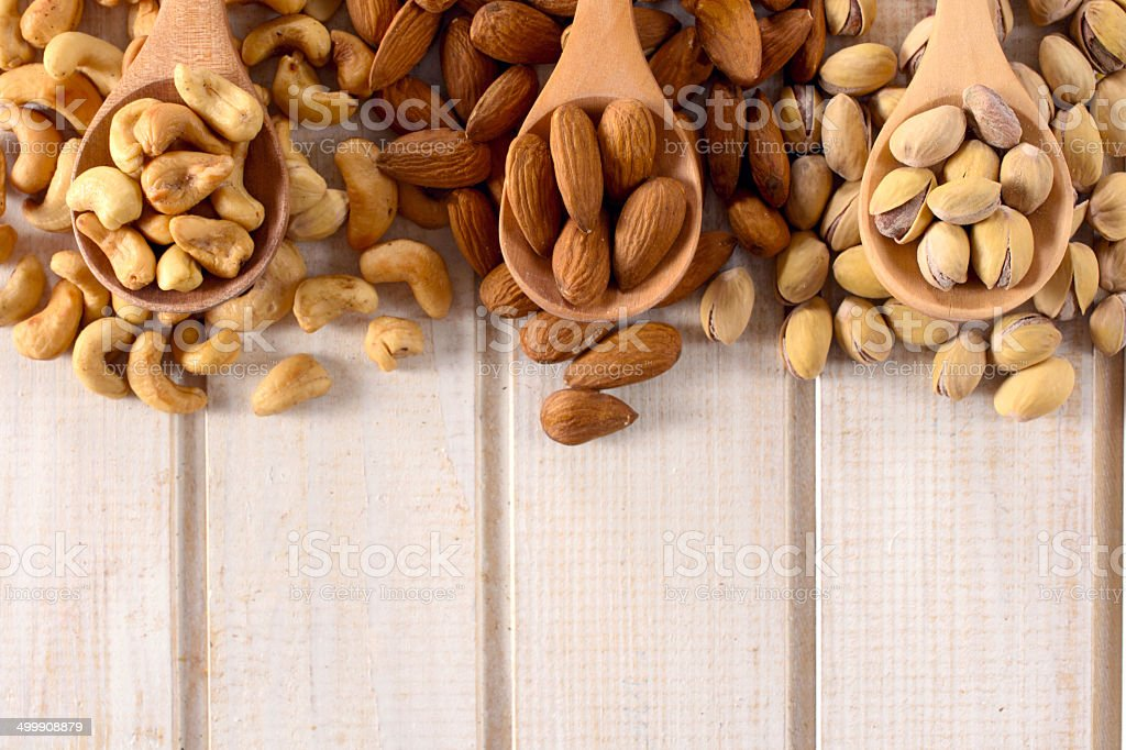 Nuts mix in ladles stock photo