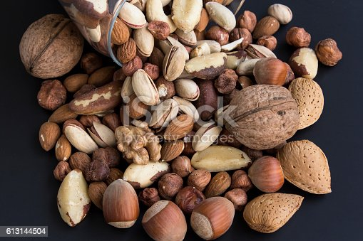 istock Nuts Mix on a Black Background 613144504