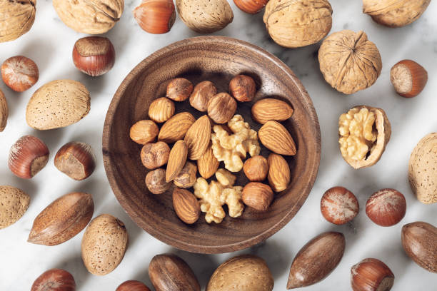Nuts Mixed in a wooden plate stock photo