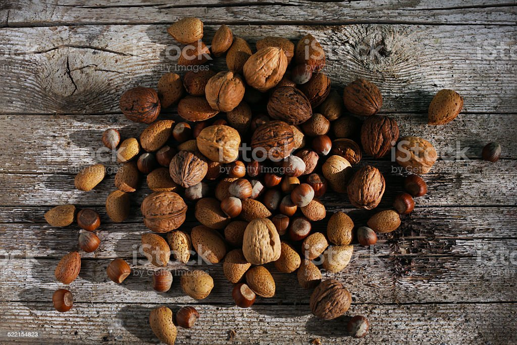 Nuts mixed in kernels, walnuts, hazelnuts and almonds stock photo