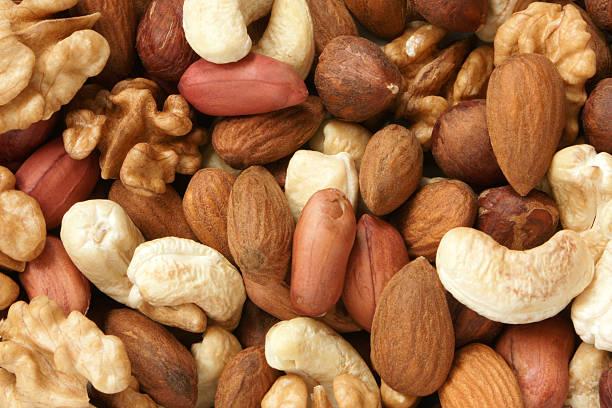 орехи комбинированный - nuts стоковые фото и изображения