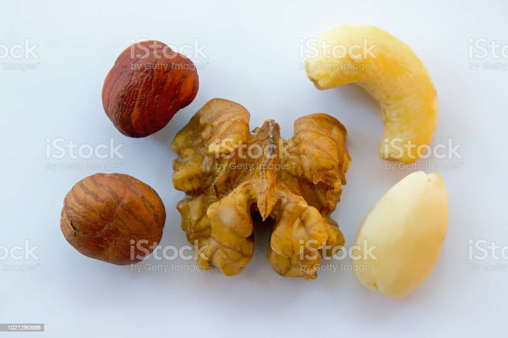 Nuts mixture hazelnuts, almonds, walnut, cashew on white background -...