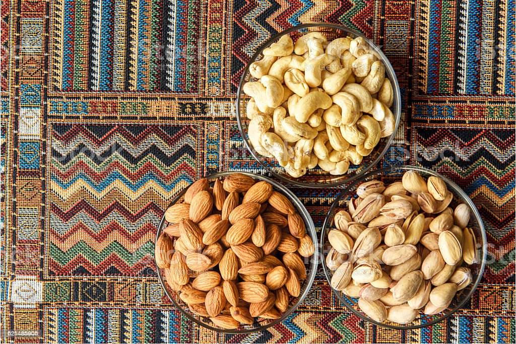 Nuts on a traditional Arabian carpet photo libre de droits