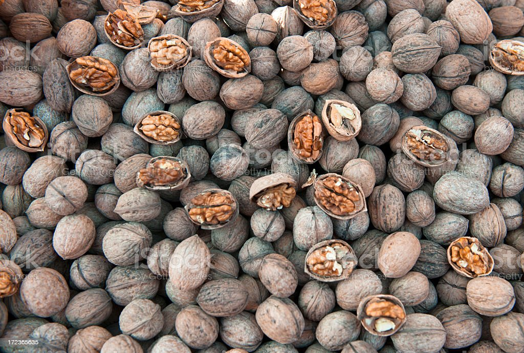 Nuts on market stall : walnuts with shell, some open royalty-free stock photo