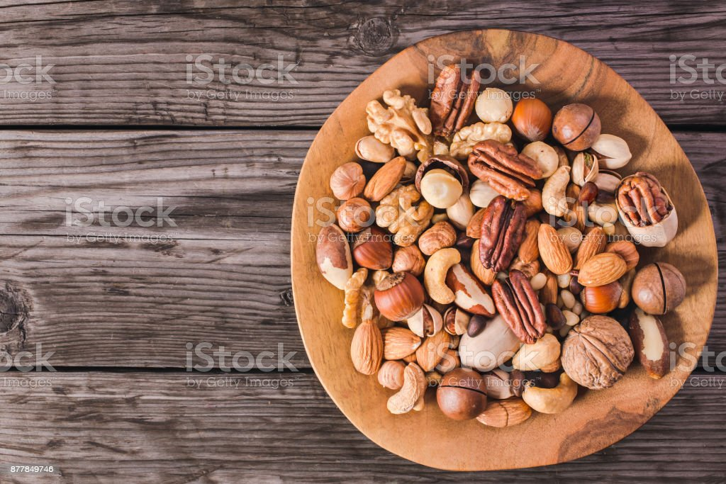Nuts on plate above stock photo