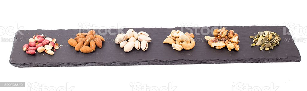Nuts on slate royaltyfri bildbanksbilder