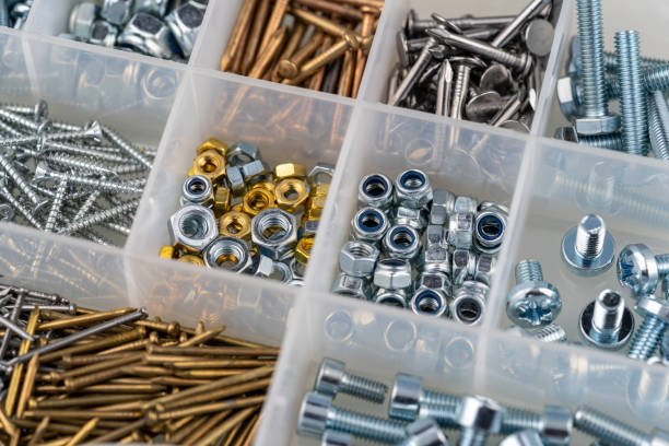 nuts, screws and nails in a toolbox macro view stock photo